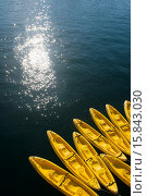 Yellow kayaks tied up to the cruise ship Safari Endeavour in the bay of Aqua Verde, a small fishing village near Loreto, Sea of Cortez in Baja California, Mexico. Стоковое фото, фотограф Wolfgang Kaehler / age Fotostock / Фотобанк Лори
