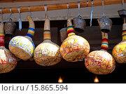 Купить «Colourful gourds and cattle bells hanging outside shop.», фото № 15865594, снято 20 февраля 2019 г. (c) age Fotostock / Фотобанк Лори