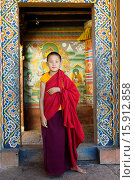Young novice monk standing in doorway of Chimi Lakhang temple in the old capital. Стоковое фото, фотограф © Eye Ubiquitous / Nic I'Anson / age Fotostock / Фотобанк Лори