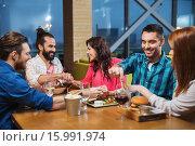 Купить «friends eating and tasting food at restaurant», фото № 15991974, снято 8 ноября 2015 г. (c) Syda Productions / Фотобанк Лори