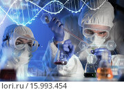 Купить «close up of scientists making test in lab», фото № 15993454, снято 4 декабря 2014 г. (c) Syda Productions / Фотобанк Лори