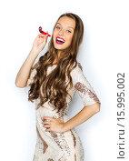 Купить «happy young woman or teen girl in fancy dress», фото № 15995002, снято 31 октября 2015 г. (c) Syda Productions / Фотобанк Лори