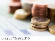 Купить «close up of euro paper money and coins on table», фото № 15995310, снято 30 июля 2015 г. (c) Syda Productions / Фотобанк Лори