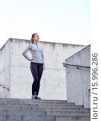 Купить «smiling sportive woman on stairs at city», фото № 15996286, снято 17 октября 2015 г. (c) Syda Productions / Фотобанк Лори