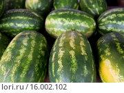 Купить «close up of watermelon at street farmers market», фото № 16002102, снято 27 июля 2015 г. (c) Syda Productions / Фотобанк Лори