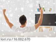 Купить «man watching tv and supporting team at home», фото № 16002670, снято 29 января 2015 г. (c) Syda Productions / Фотобанк Лори