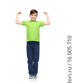 Купить «happy boy in polo t-shirt showing strong fists», фото № 16005710, снято 6 ноября 2015 г. (c) Syda Productions / Фотобанк Лори