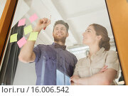 Купить «happy creative team writing on blank office glass», фото № 16006542, снято 29 марта 2015 г. (c) Syda Productions / Фотобанк Лори