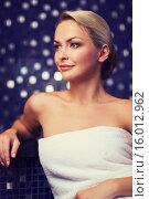 Купить «beautiful young woman sitting in bath towel», фото № 16012962, снято 15 декабря 2014 г. (c) Syda Productions / Фотобанк Лори