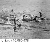 Купить «Manhasset, Long Island, New York c. 1929. A fast combination of tennis and aquaplaning, this new sport is sure to be the favorite of ball manufacturers...», фото № 16080478, снято 15 октября 2018 г. (c) age Fotostock / Фотобанк Лори