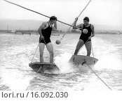 Купить «United States: c. 1931.Two men aquaplane jousting at 40 mph.», фото № 16092030, снято 18 августа 2018 г. (c) age Fotostock / Фотобанк Лори