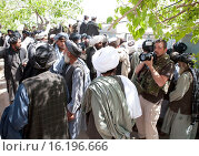 Купить «Photographer Ton Koene as work in Afghanistan.», фото № 16196666, снято 20 марта 2010 г. (c) age Fotostock / Фотобанк Лори