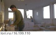 Купить «Couple Spending Evening at Home», видеоролик № 16199110, снято 17 октября 2015 г. (c) Данил Руденко / Фотобанк Лори