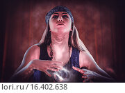 Купить «Composite image of fortune teller using crystal ball», фото № 16402638, снято 21 октября 2018 г. (c) Wavebreak Media / Фотобанк Лори