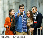 Купить «Group of friends shooting mutual portrait on cell phone», фото № 16408562, снято 23 января 2019 г. (c) Яков Филимонов / Фотобанк Лори