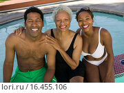 Senior woman with couple at swimming pool elevated view portrait. Стоковое фото, фотограф West Coast Surfer / easy Fotostock / Фотобанк Лори