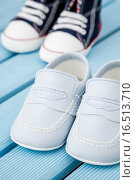 Купить «Pairs of Dark Blue, White Baby Sneakers and Blue Baby Shoes», фото № 16513710, снято 26 апреля 2019 г. (c) PantherMedia / Фотобанк Лори