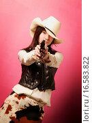 Купить «Cowgirl with gun», фото № 16583822, снято 10 декабря 2018 г. (c) easy Fotostock / Фотобанк Лори