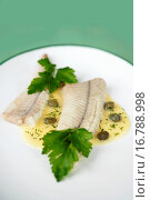 Купить «Eel fillets with caper sauce», фото № 16788998, снято 7 апреля 2020 г. (c) easy Fotostock / Фотобанк Лори