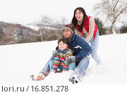 Купить «Family In Snow Riding On Sledge», фото № 16851278, снято 3 июля 2020 г. (c) easy Fotostock / Фотобанк Лори