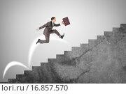 Купить «Бизнесмен бежит вверх по лестнице», фото № 16857570, снято 19 сентября 2019 г. (c) Кирилл Черезов / Фотобанк Лори
