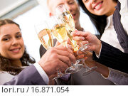 Купить «Close_up of friends hands holding glasses with champagne and making cheers», фото № 16871054, снято 22 мая 2018 г. (c) easy Fotostock / Фотобанк Лори