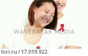 Купить «Happy couple embracing and looking at the camera», видеоролик № 17019922, снято 31 мая 2020 г. (c) Wavebreak Media / Фотобанк Лори