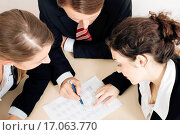 Купить «Businesspeople working on spreadsheet», фото № 17063770, снято 25 апреля 2019 г. (c) easy Fotostock / Фотобанк Лори