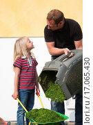 Купить «Father and daughter mowing lawn together», фото № 17065430, снято 25 мая 2018 г. (c) easy Fotostock / Фотобанк Лори
