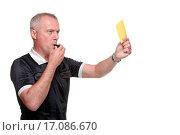 Купить «Referee showing the yellow card side profile», фото № 17086670, снято 3 апреля 2020 г. (c) easy Fotostock / Фотобанк Лори