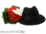 Мужская шляпа и цветок на белом фоне. Стоковое фото, фотограф Оксана Якупова / Фотобанк Лори