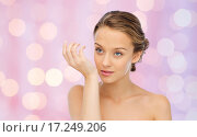 woman smelling perfume from wrist of her hand. Стоковое фото, фотограф Syda Productions / Фотобанк Лори