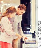 Купить «happy couple choosing engagement ring in mall», фото № 17250726, снято 10 ноября 2014 г. (c) Syda Productions / Фотобанк Лори
