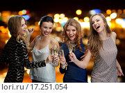 Купить «happy women clinking champagne glasses over lights», фото № 17251054, снято 21 ноября 2015 г. (c) Syda Productions / Фотобанк Лори