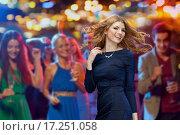Купить «happy young woman dancing at night club disco», фото № 17251058, снято 21 ноября 2015 г. (c) Syda Productions / Фотобанк Лори