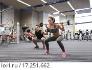 Купить «young man and woman training with barbell in gym», фото № 17251662, снято 30 ноября 2014 г. (c) Syda Productions / Фотобанк Лори