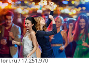 Купить «happy young women dancing at night club disco», фото № 17251970, снято 21 ноября 2015 г. (c) Syda Productions / Фотобанк Лори