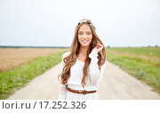 Купить «smiling young hippie woman on cereal field», фото № 17252326, снято 27 августа 2015 г. (c) Syda Productions / Фотобанк Лори