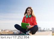 Купить «happy young woman with tablet pc and headphones», фото № 17252954, снято 19 марта 2015 г. (c) Syda Productions / Фотобанк Лори