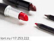 Купить «close up of two open lipsticks and lip pencils», фото № 17253222, снято 19 ноября 2015 г. (c) Syda Productions / Фотобанк Лори
