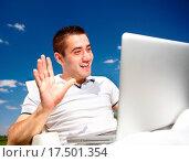 Купить «Happy young man working in the field. Beautiful summer sky.», фото № 17501354, снято 20 апреля 2019 г. (c) easy Fotostock / Фотобанк Лори
