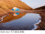Купить «A forzen small tent in cold high moutain lake.», фото № 17603846, снято 23 сентября 2018 г. (c) easy Fotostock / Фотобанк Лори