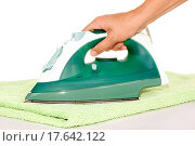 hand with an iron and ironing a towel. Стоковое фото, фотограф Valery / easy Fotostock / Фотобанк Лори
