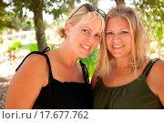 Купить «Two Beautiful Smiling Sisters Ourdoor Portrait», фото № 17677762, снято 10 июля 2020 г. (c) easy Fotostock / Фотобанк Лори
