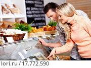 Купить «The couple specifies in purchase in shop», фото № 17772590, снято 14 июля 2020 г. (c) easy Fotostock / Фотобанк Лори