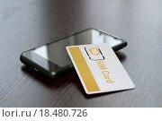 SIM card and mobile phone. Стоковое фото, фотограф Deyan Georgiev / easy Fotostock / Фотобанк Лори