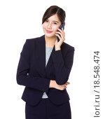 Купить «Asian Businesswoman chat on mobile phone», фото № 18548474, снято 17 января 2020 г. (c) PantherMedia / Фотобанк Лори
