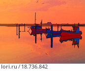 Magical reflection of a small dinghy dory boats digitally altere. Стоковое фото, фотограф Ron Zmiri / easy Fotostock / Фотобанк Лори