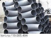 Купить «Трубы и отводы стальные на заводском складе», фото № 19005494, снято 8 февраля 2014 г. (c) Сергеев Валерий / Фотобанк Лори