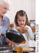 Купить «Grandmother and granddaughter making pancakes», фото № 19374034, снято 23 февраля 2011 г. (c) easy Fotostock / Фотобанк Лори